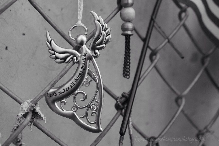 This beautiful angel hangs on the same fence that at time fenced in the actual bomb site.