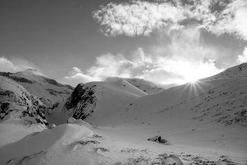 sun snow mountains clouds switzerland